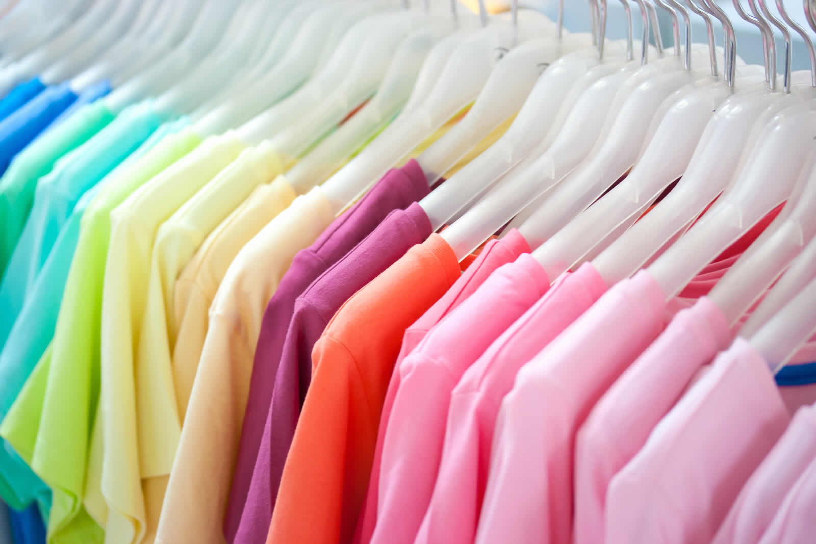 colourful t-shirts on a rail