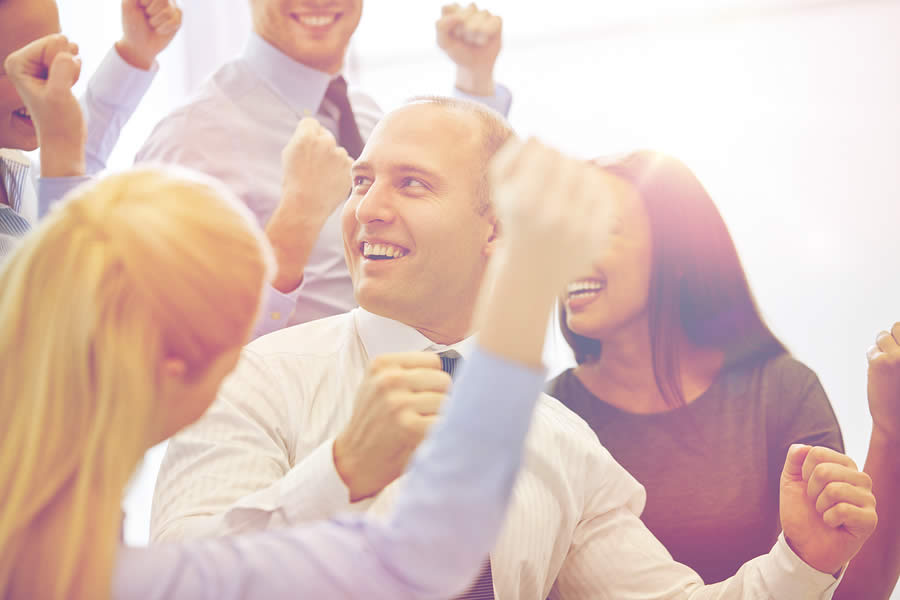 People celebrating business success